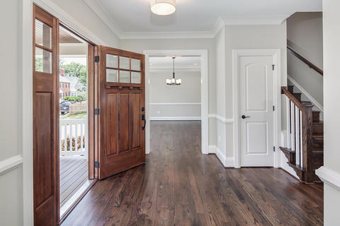 Transitional Entry with cherry wood stained windowed entry door