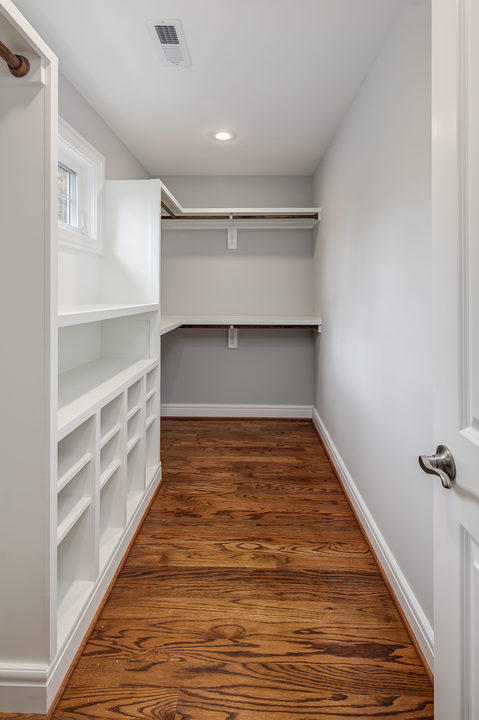 Traditional Closet with beautiful functional closet