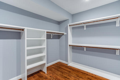 Traditional Closet with storage shelves