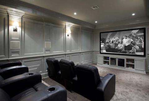 Transitional Home Theater with black leather theater seating