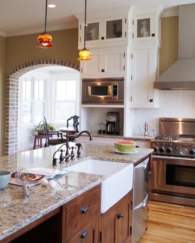 Transitional kitchen in minneapolis exposed range hood for Barn style kitchen sink