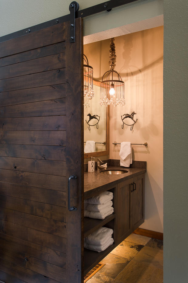 southwestern bathroom in salt lake sliding barn door western themed