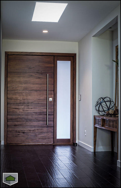 Modern Entry with hand scraped plank wood floor