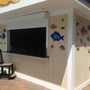 Tropical Outdoor Kitchen with black solid surface bar top