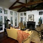 English Country Living Room with dark stained exposed beams