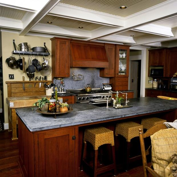 Eclectic Kitchen with medium stained recessed wood cabinetry