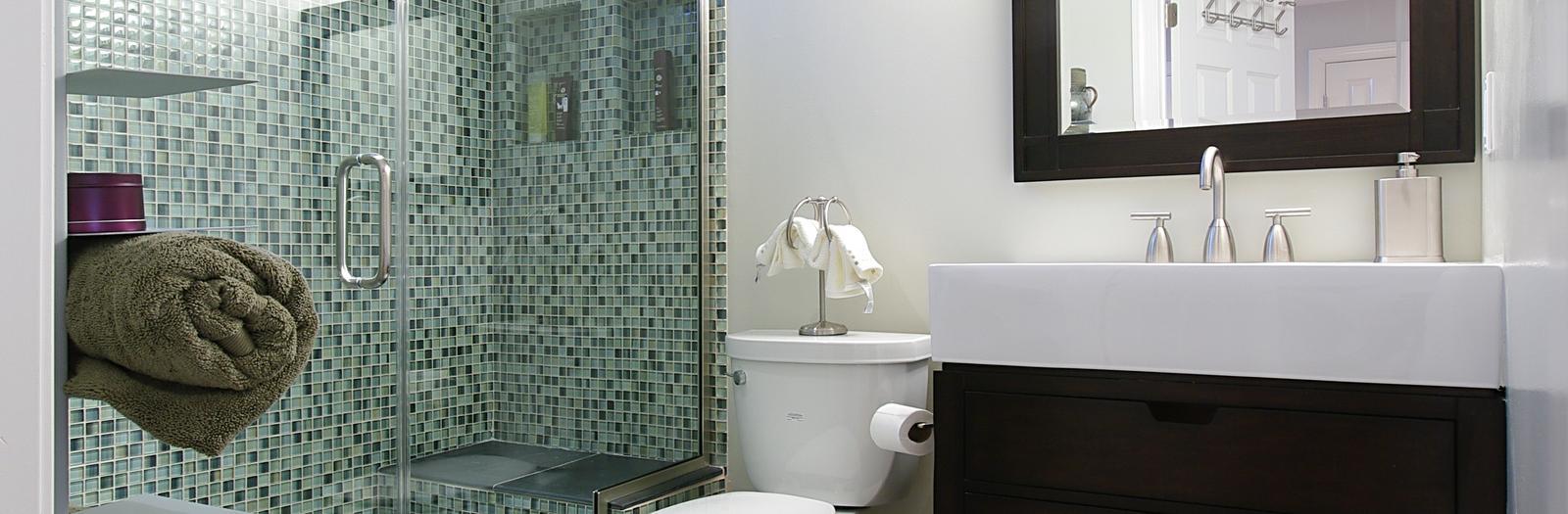 Contemporary Bathroom With Dark Wood Framed Vanity Mirror