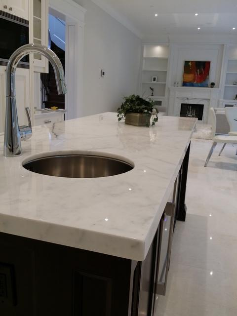Cape Cod Kitchen with silver stainless steel high arc faucet