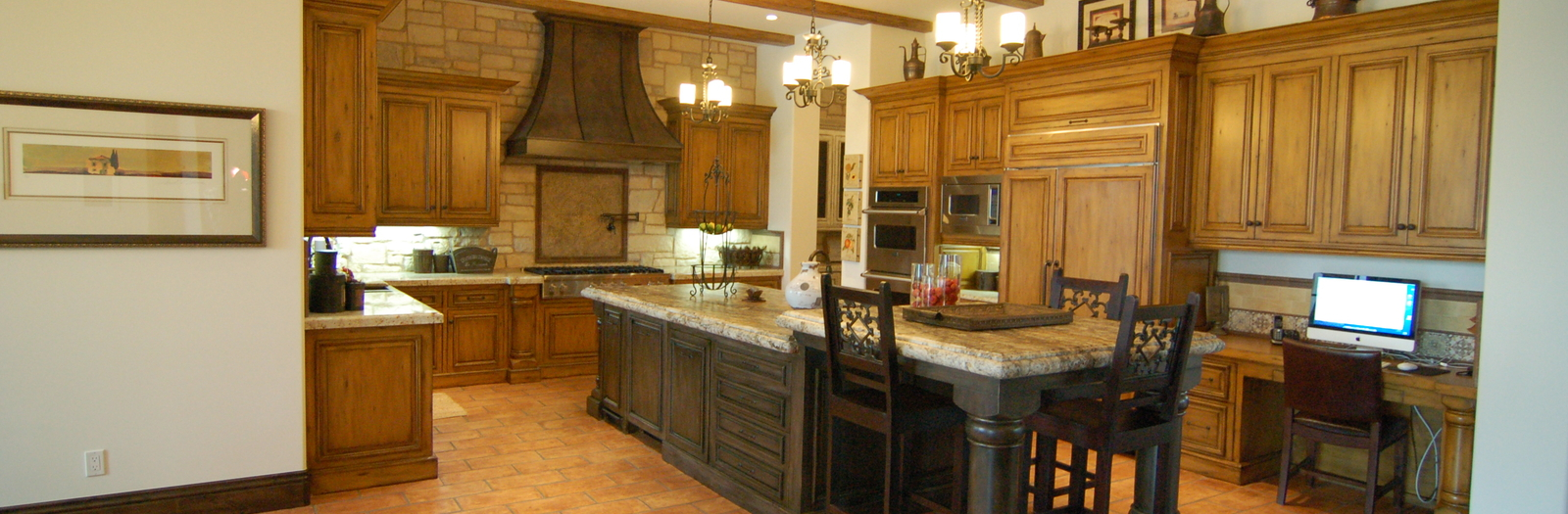 Lodge Kitchen with large dark wood island with bar seating