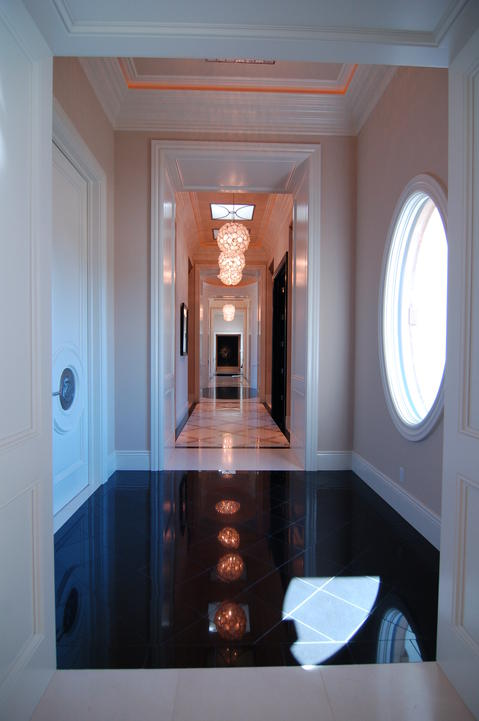 Eclectic Entry with white and gold marble tile with black trim