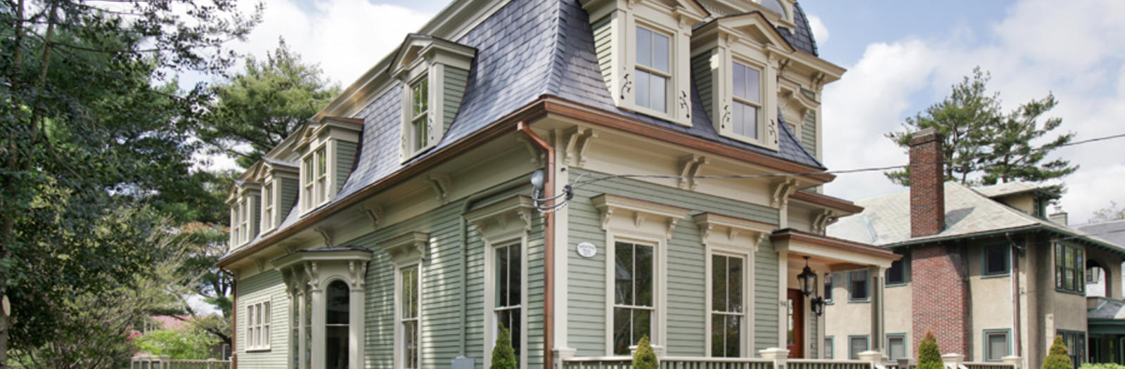 Victorian Home Exterior with decorative molding around windows