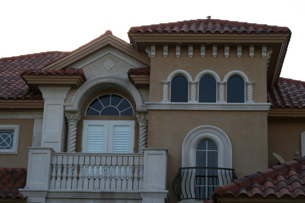 Mediterranean Home Exterior In Cape Coral Arched Windows French Doors By Top Stucco Stone