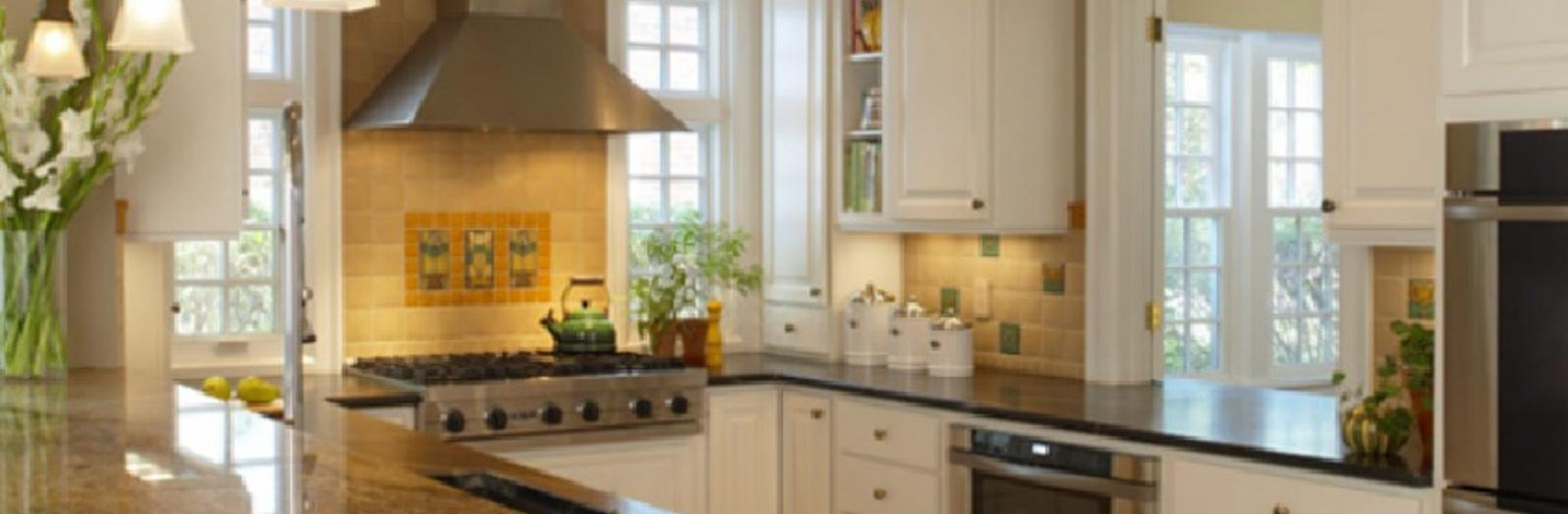 Transitional Kitchen with white raised panel cabinetry