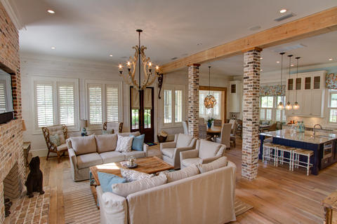 Transitional Family Room with rustic style chandelier