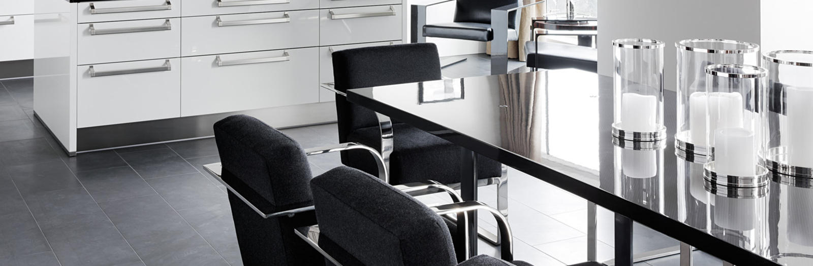 Modern Kitchen with black upholstered dining chairs with chrome arm rests