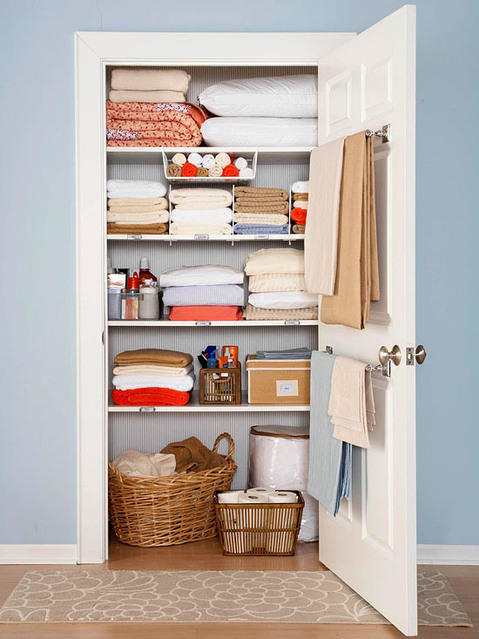Transitional Closet with light blue painted walls