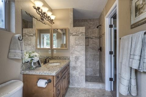 Transitional Bathroom with mosaic tile accent stripe
