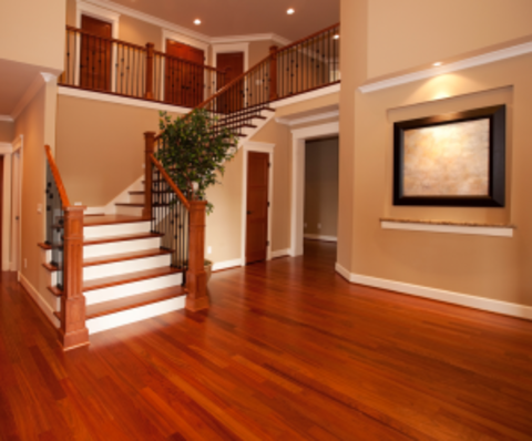 Traditional Entry with cherry stained handrails and wrought iron balusters