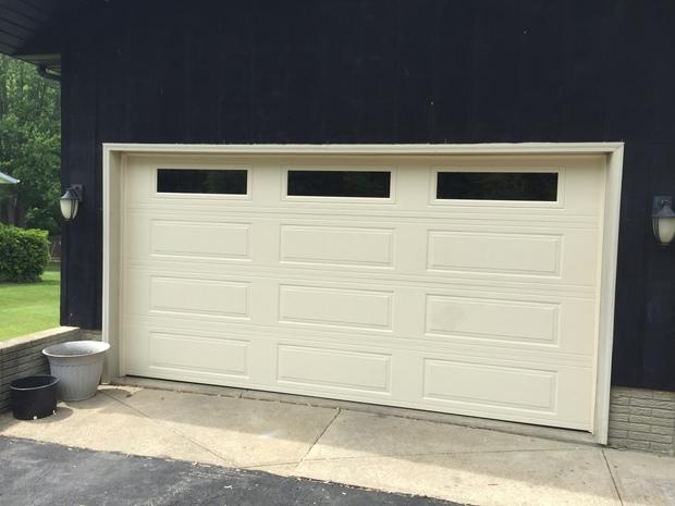 Contemporary garage in lorain concrete brick foundation for Wood veneer garage doors