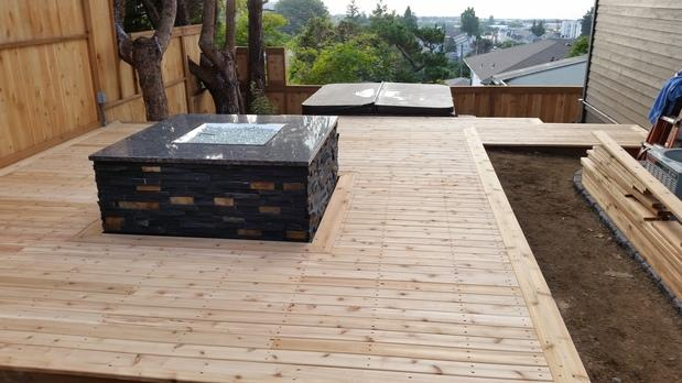 Traditional Deck In Shoreline Privacy Fence Raised Fire