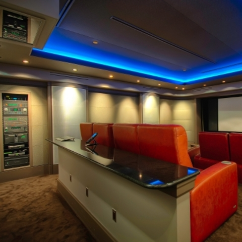 Modern Home Theater with red leather theater chair