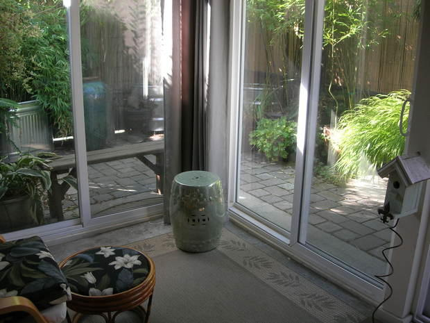 Asian sunroom in portland cobblestone patio potted for Sliding glass doors sunroom