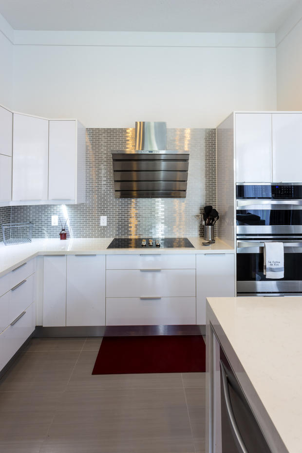 Modern Kitchen in Pembroke Pines - white counters, white cabinets | by Fresh Floor Kitchen & Bath, LLC