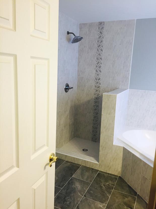 Contemporary Bathroom In Woodbridge Tile Floor Wall Mount Shower Head By Ascencio Flooring