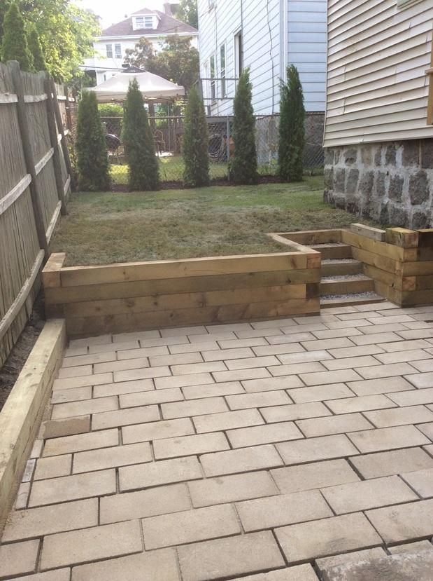 Traditional patio in salem stone foundation wood for Outdoor deck privacy solutions
