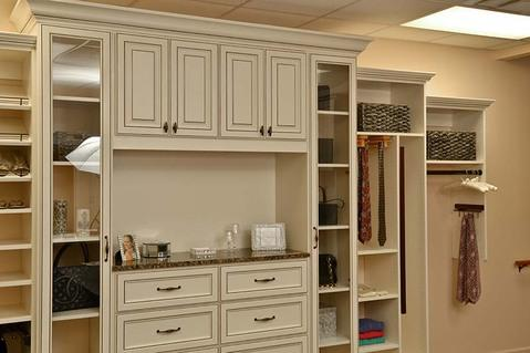 Modern Closet with recessed panel cabinet face with glazed accents