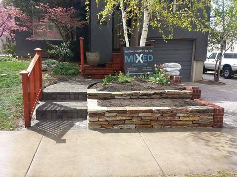 Eclectic Landscape with ledger stone raised flower beds