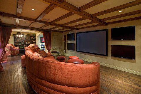 Eclectic Home Theater with hand scraped plank wood floor