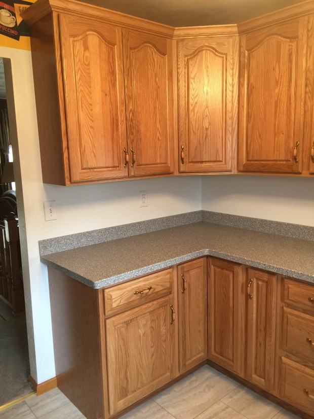 Transitional Kitchen In Springfield Wood Plank Ceramic Tile Floor Stained Wood Cabinets By