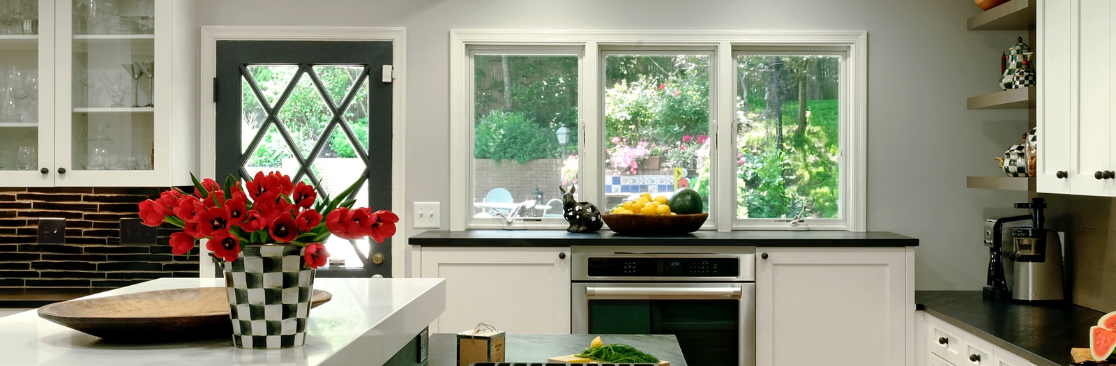 Transitional Kitchen with white solid surface countertop
