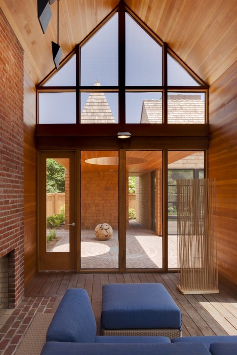 Modern Sunroom with floor to ceiling window