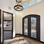 Tuscan Entry with wrought iron and candle chandelier