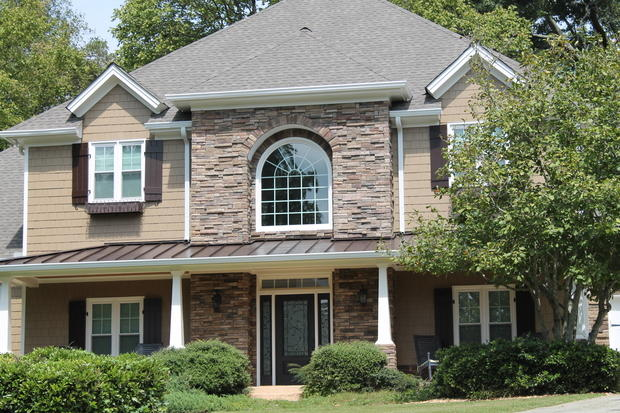 Traditional Home Exterior In Norcross Metal Roof Stone Column