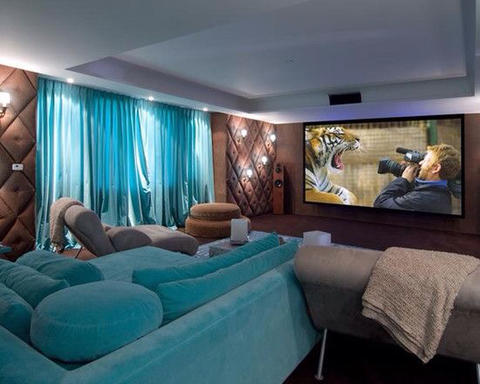 Eclectic Home Theater with lounge style sectional