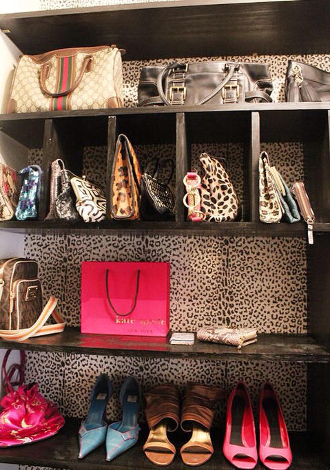 Contemporary Closet with animal print wall paper