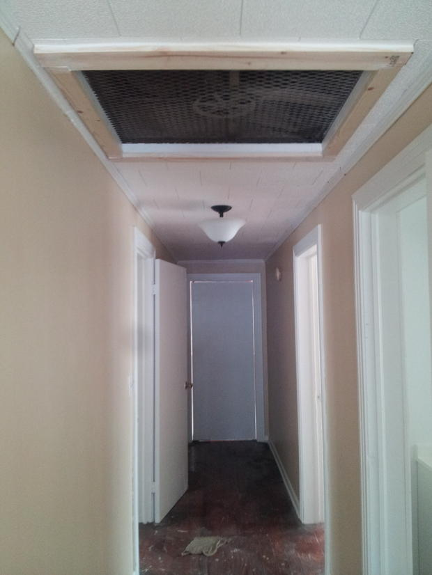 Transitional Hallway With White Floor Molding