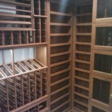 Contemporary Wine Cellar with wire glass cabinets