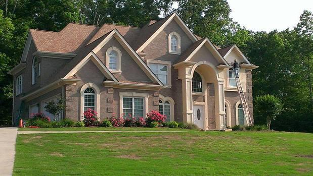French country home exterior in mcdonough biege brick for French country brick exterior