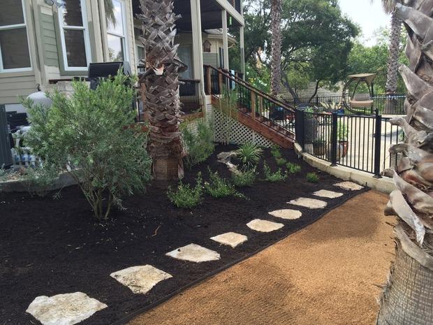 Southwestern landscape in austin dark mulch light mulch for Home turf texas landscape design llc