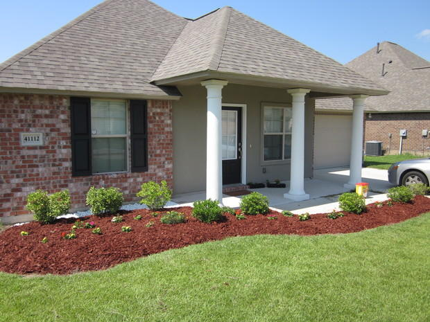 Traditional home exterior in gonzales front load garage for Home designs unlimited llc