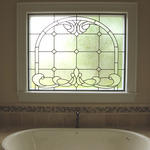 Traditional Bathroom with drop in tub with tile surround