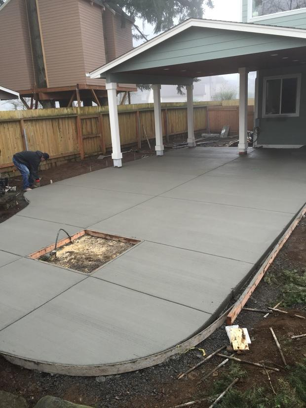 Transitional Patio With Poured Concrete Patio Pad