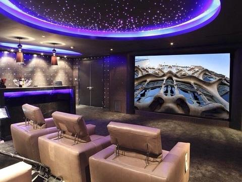 Traditional Home Theater with beige leather theater seat