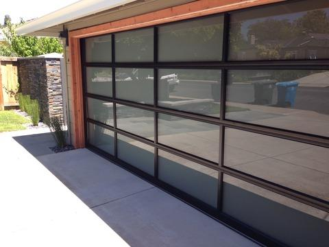 Modern Garage with aluminum and glass two car garage door