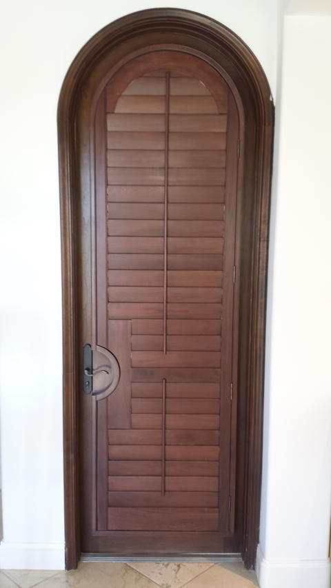 Transitional Closet with dark stained wood closet door