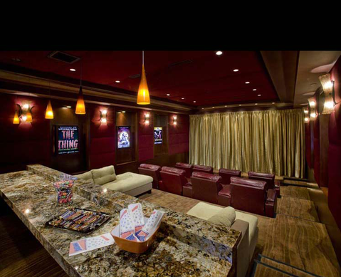 Traditional Home Theater with beige granite countertop